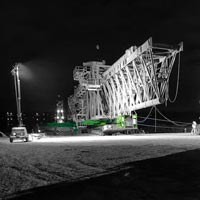 deselected thumbnail button of a nighttime scene of Omega Morgan specialized transportation crews moving a ship loader on a 6 line KMAG SPMT