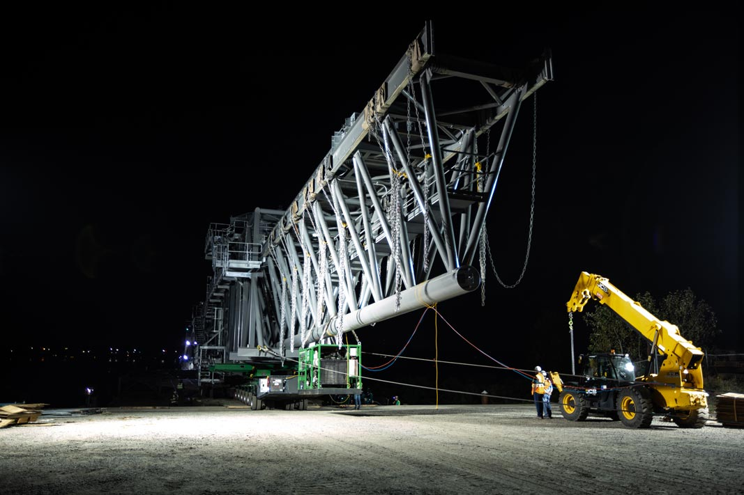a ship loader in Vancouver, Washington being transported at night