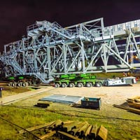 selected thumbnail button of a 530,000 pound ship loader on top of a green KMAG 6-line SPMT at night