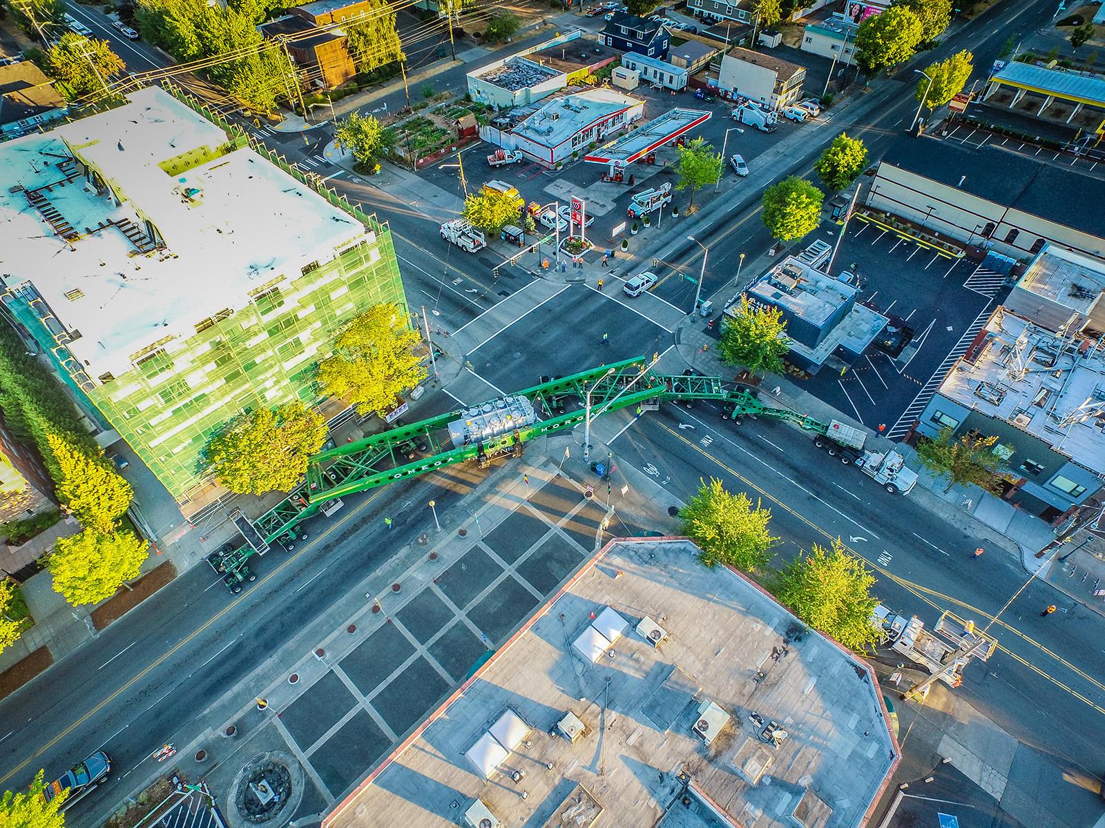 High frame trailer maneuvering 418,000lb transformer through city streets