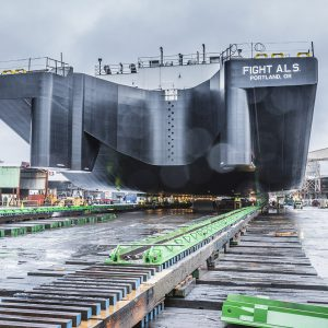 Moving 4,000 ton barge utilizing Omega Morgan heavy slide system