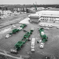 deselected thumbnail button of Omega Morgan's one hundred fifty ton dual lane transporter and one hundred sixty dual lane transporter parked near Stack Metallurgic's Albany facility where two Omega Morgan cranes are lifting the new hot isostatic press into a building