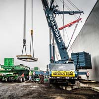 selected thumbnail button of Omega Morgan cranes lifting a hot isostatic press piece from a dual lane transporter in Albany, Oregon