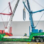 Omega Morgan crews with two five hundred fifty ton cranes lifting a piece of a hot isostatic press in Albany Oregon
