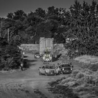 deselected thumbnail button of Omega Morgan team transporting a large transformer on a dirt road
