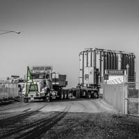 deselected thumbnail button of Omega Morgan specialized transportation team offloads a large transformer from a trailer to a waiting barge at the Port of Morrow