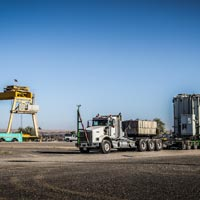 selected thumbnail button of omega morgan specialized transportation with a large transformer ready to load onto a barge at the Port of Morrow