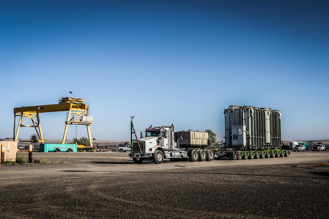 omega morgan specialized transportation with a large transformer ready to load onto a barge at the Port of Morrow