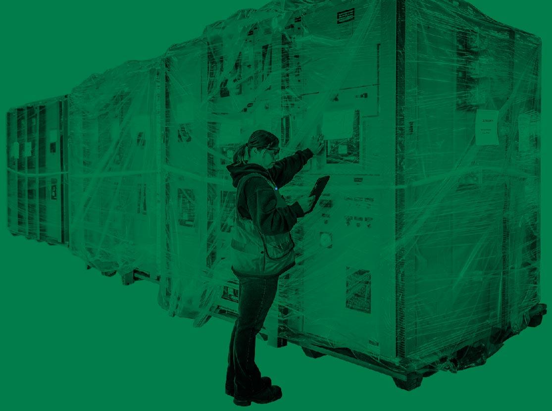 Omega Morgan employee checking inventory at warehouse and storage facility